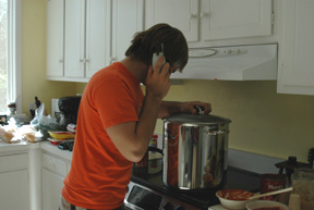 On the phone but still tending to the sauce, very important!