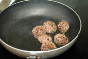 Browning the meatballs.