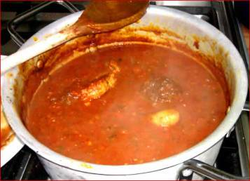 A pot of pasta sauce and meatballs